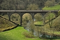 >Cyclists on the Headstone Viaduct by Rod Johnson