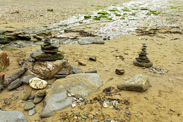 Stacked Stones on Durgan Beach, Cornwall by Rod Johnson