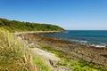 >The Rugged Castle Beach, Falmouth by Rod Johnson