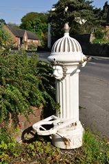 Landscape scene of Ticknall Village Water Tap. Link to Water Wells, Fountains & Features Gallery.