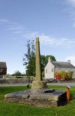 A view of the Village Cross on the green at Monyash in Derbyshire, England. Link to Crosses Gallery.